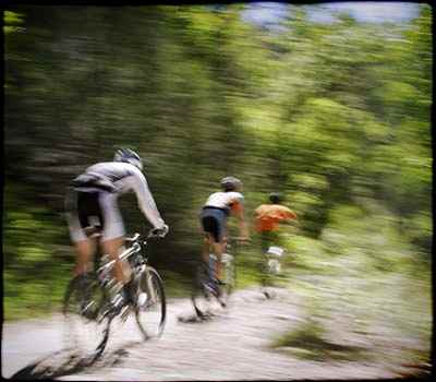 3 bikes on trail