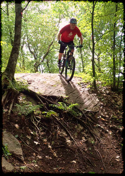MTB rider on rock